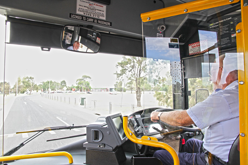 A Driver Driving A Bus With Driver Tracking Technology