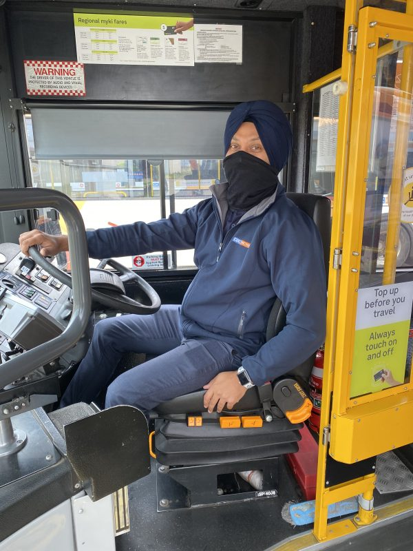 CDC Victoria driver at the wheel wearing a face mask