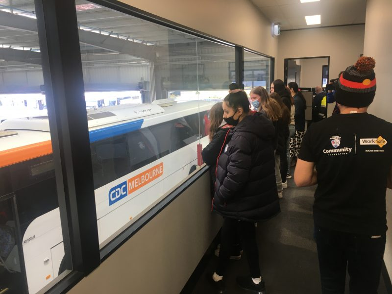 Indigenous youth overlooking the workshop at CDC Wyndham