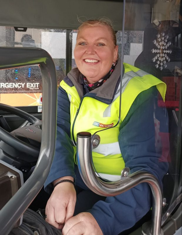 Friendly bus driver smiling
